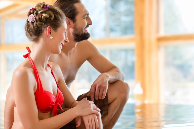 Couple relaxing together at wellness spa pool