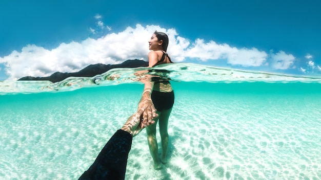 Couple relaxing underwater beautiful ocean at koh lipe beach thailand