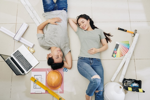 Couple resting after home repair