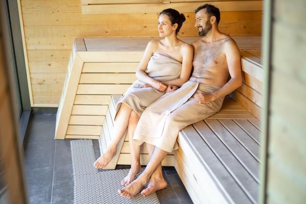 Couple resting in a sauna