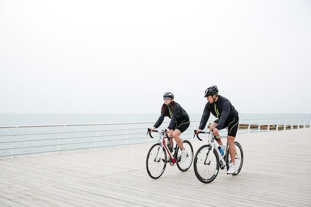 Couple riding on the beach