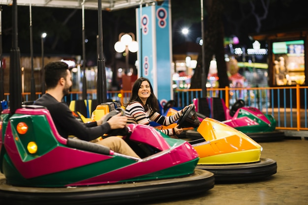 Couple riding the bumper cars
