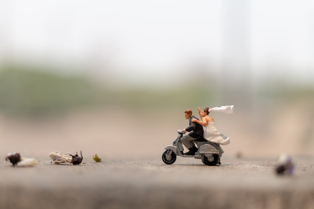 Couple riding the motorcycle in the garden