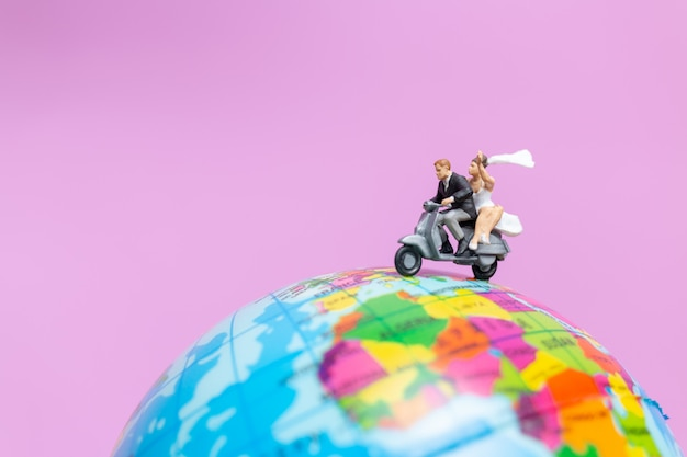 Couple riding the motorcycle on the globe , valentines concept