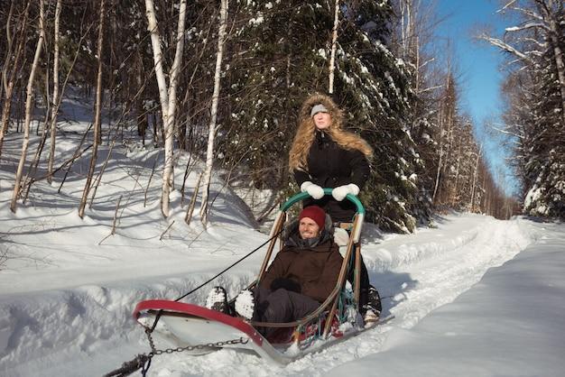 Couple riding the sledge