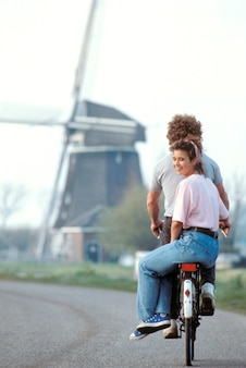 Couple riding together on bicycle, holland