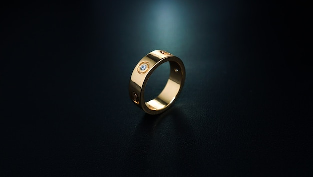 Couple ring with beautiful pearl accents accompanied by a dark background