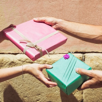 Couple's hand exchanging valentine gift
