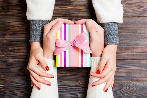 Couple's hands holding a christmas gift