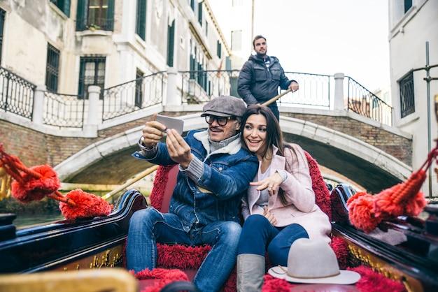 Couple sailing on venetian gondola