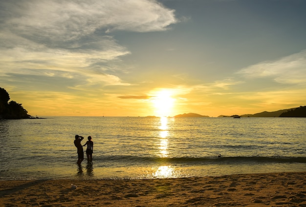 Couple see the romantic sunset at the seaside