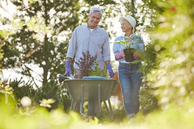 Couple of senior farmers in garden