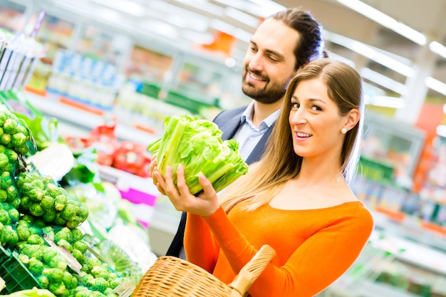 Couple shopping groceries in supermarket