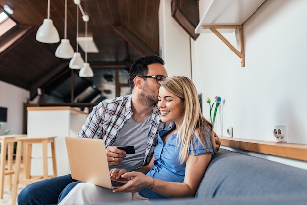 Couple shopping online at home.