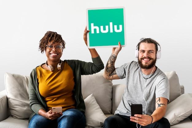 Couple showing a hulu icon