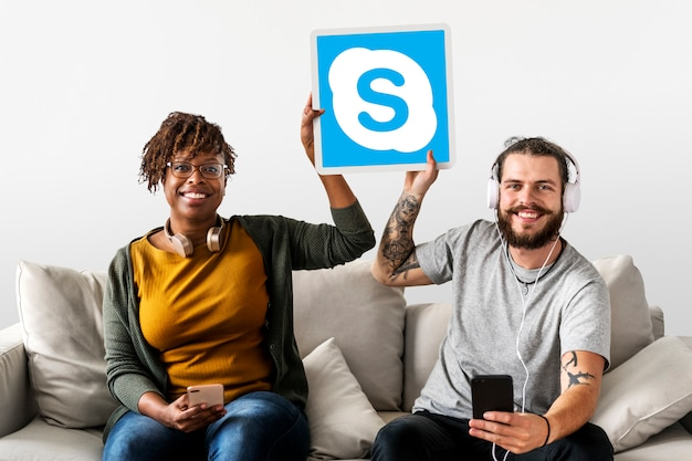 Couple showing a skype icon