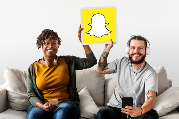 Couple showing a snapchat icon