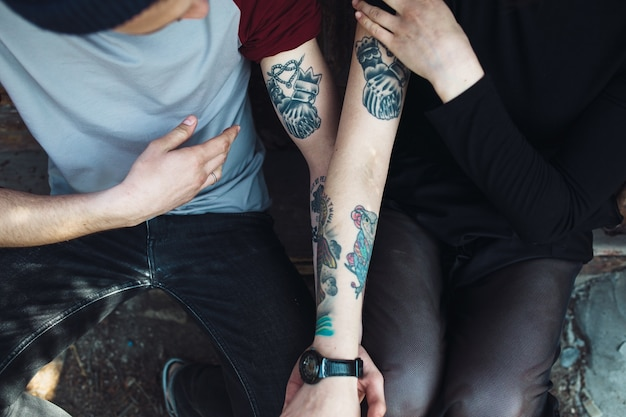 Couple showing their tattoos on their arms