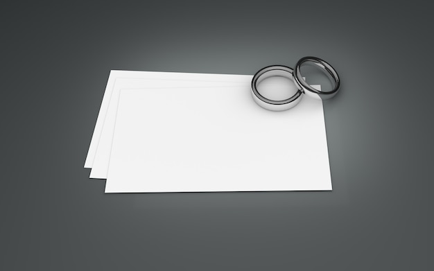 A couple of silver rings on white paper. 3d illustration