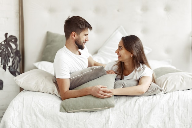 Couple sitting on a bed in a room
