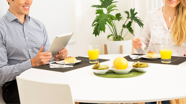 Couple sitting on breakfast table