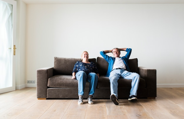 Couple sitting on a brown couch