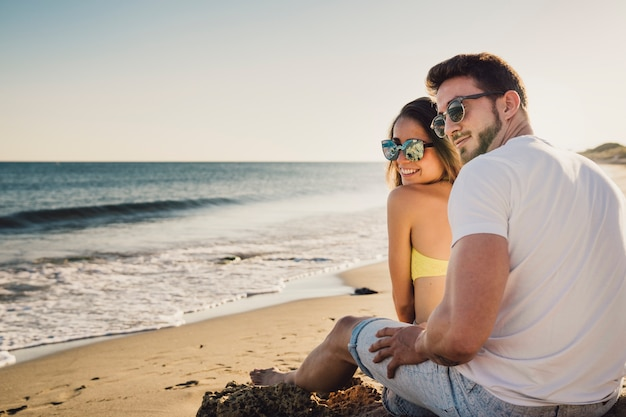 Couple sitting by the shoreline