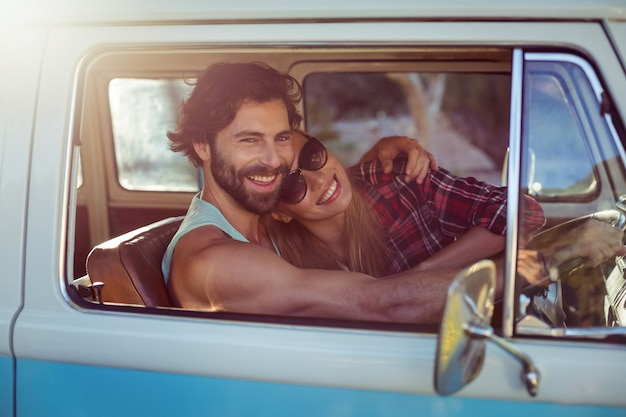 Couple sitting in a campervan