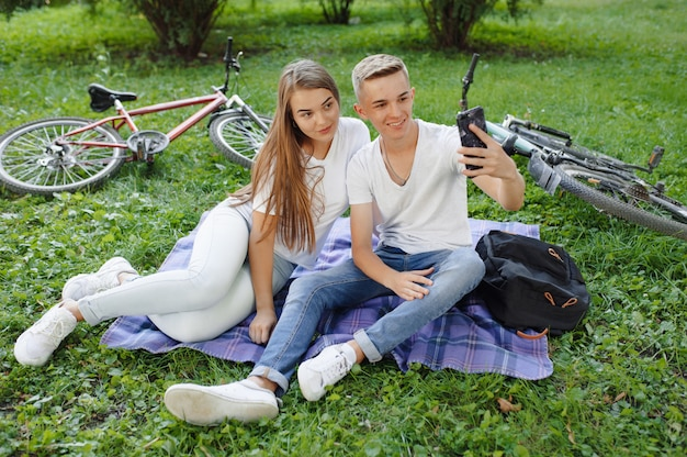 Couple sitting in a park with bicycle
