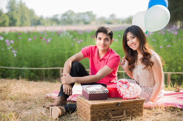 Couple sitting picnic