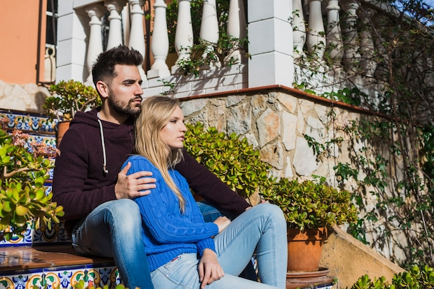Couple sitting on stairs outdoor cute