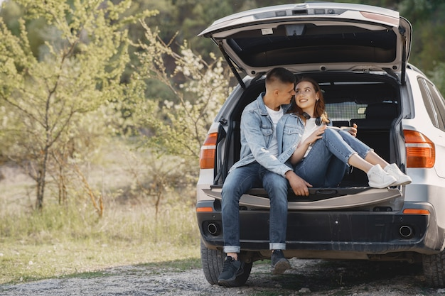 Couple sitting in a trunk in a park