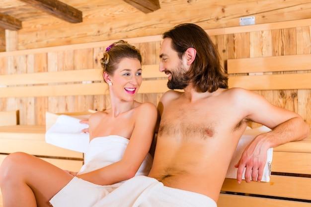 Couple sitting in wellness spa sauna
