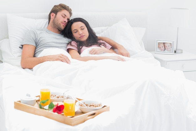 Couple sleeping in their bed