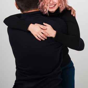 Couple smiling embraced for valentines