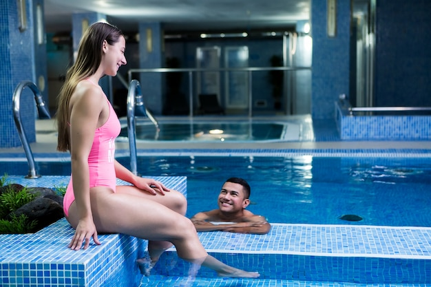 Couple smiling at poolside