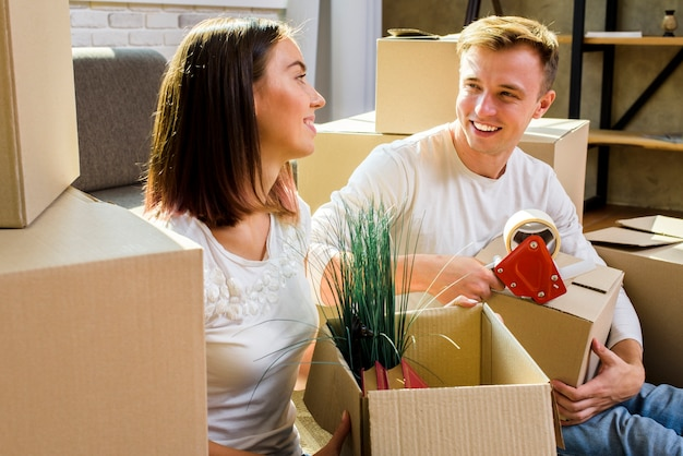 Couple smiling while packing thinkgs