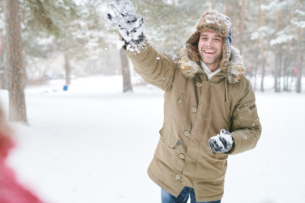 Couple at snowball fight in forest