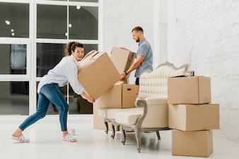 Couple sorting carton boxes