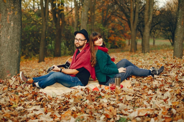 Couple spend time in a autumn park