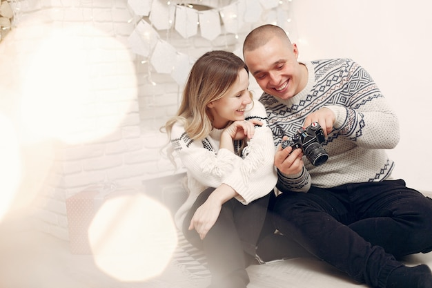 Couple spend time at home and making a photos