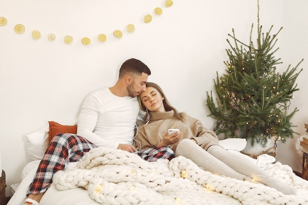 Couple spend time at home with christmas decorations