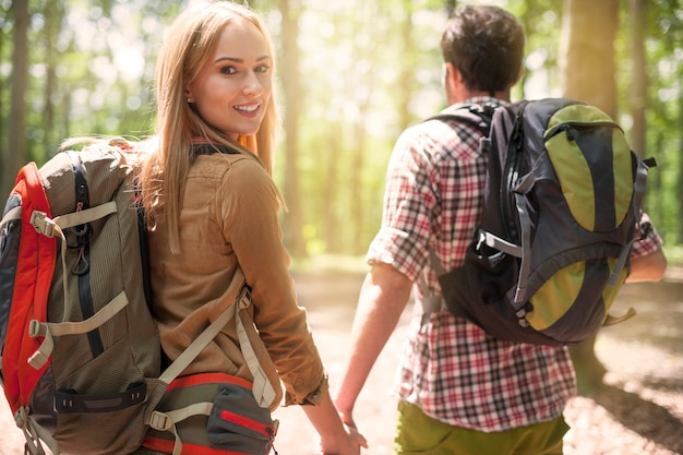 Couple spending a sunny day in the forest