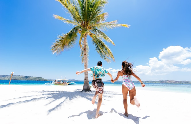 Couple spending time on a beutiful remote tropical island. Concept about vacation and lifestyle.