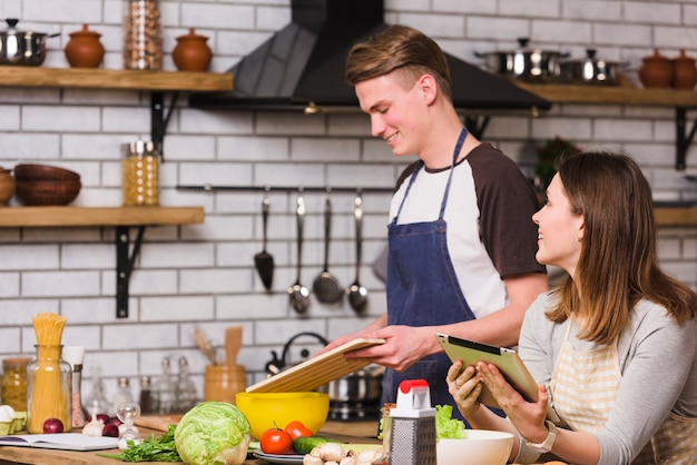 Couple spending time in kitchen cooking and chatting