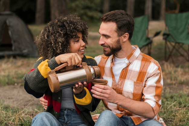 Couple spending time together camping outdoors