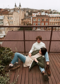 Couple spending time together on a roof