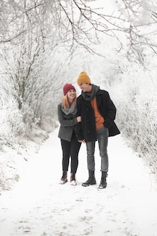 Couple spending time together and walks in snow