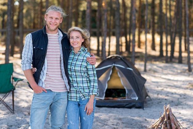 Couple standing in front of tent