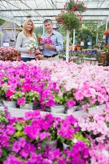 Couple standing in garden center